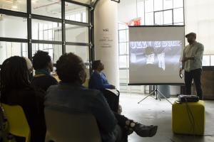 """Filmmaker Shukree Tilghman gives a presentation on his web series """"Chronicle: The Other Walter White."""""""